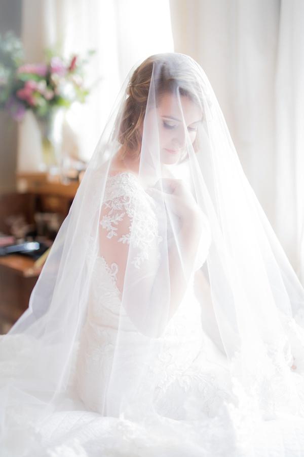 wedding portrait bride with short hair under handmade veil oleg cassini wedding dress illusion