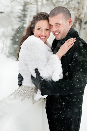 Couple in jackets during snow storm