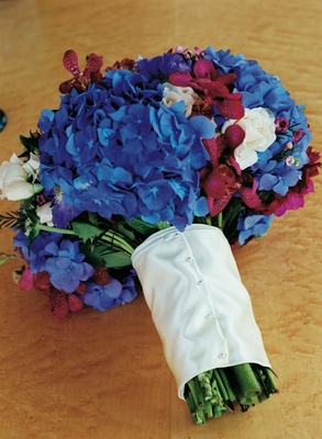 Bridal bouquet with blue hydrangeas and red orchids