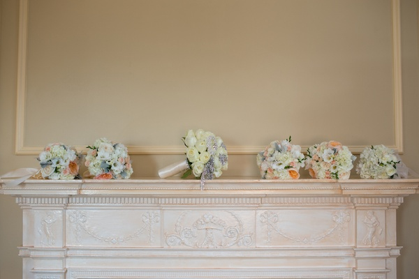 Bride's bouquet of white roses and brooches and bridesmaid bouquets of peonies, hydrangeas and roses