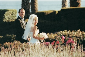 Newlyweds take a stroll with an ocean view