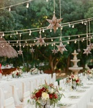 Wedding rehearsal dinner welcome party white tables low burgundy centerpiece star lantern lights