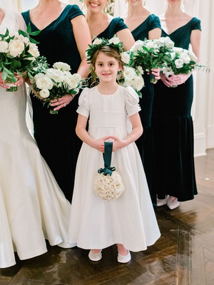 flower girl in classic white dress updo flower crown holding pomander rose bouquet green ribbon