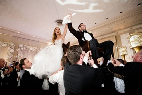 wedding reception jewish wedding tradition horah dance bride groom hoisted on chairs at reception