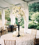 textured, 3d linens at wedding reception, black stand centerpiece with florals