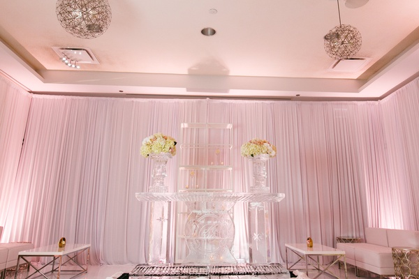 wedding lounge area with shelving of acrylic and flower display