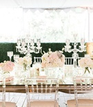 calamigos ranch tented wedding reception, crystal candelabra and clear chiavari chairs, blush floral