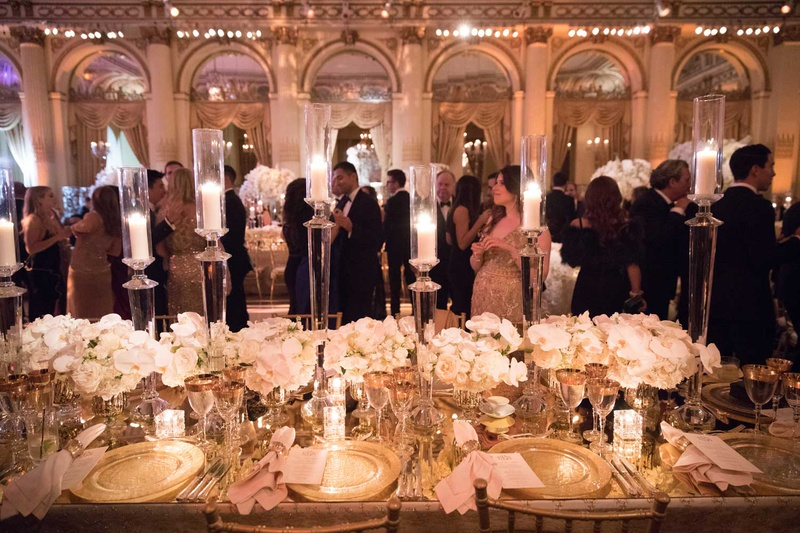 wedding reception guests hanging out at reception long table ivory centerpiece tall candles plaza