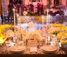 bride and grooms head table sweetheart table with candles plates skull dancefloor lit in background