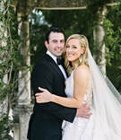Bride in Angel Sanchez illusion back wedding dress and groom in tuxedo gazebo at Oheka Castle