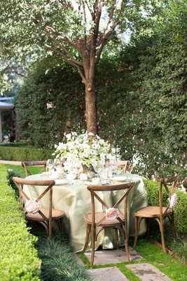 rustic verdant garden tablescape napa valley california pink rosettes wooden chairs green linens