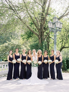 bride in illusion pronovias wedding dress with bridesmaids in scoop neck gowns bhldn white bouquets