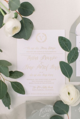 wedding invitation white stationery gold foil monogram and script white ranunculus flowers
