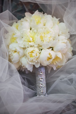 Ivory and yellow flowers on white veil