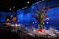 Blue reception lighting with tree centerpieces and candles
