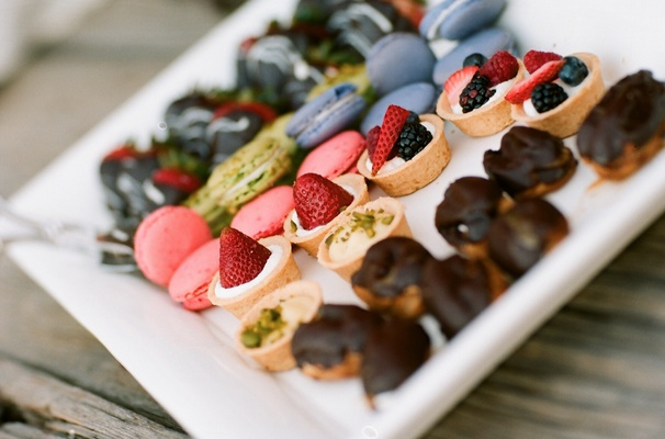 Pistachio and mixed berry tarts at wedding reception
