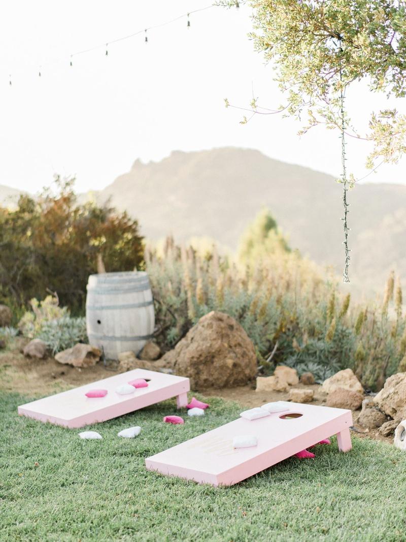 Megan Nicole YouTube singer wedding malibu outdoor cocktail hour cornhole game entertainment pink