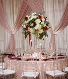 wedding reception clear chair texture linen tall centerpiece greenery white hydrangea rose red