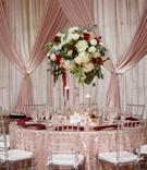 wedding reception clear chair texture linen tall centerpiece greenery white hydrangea rose red