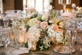 soft blush roses and white flowers with floating candles
