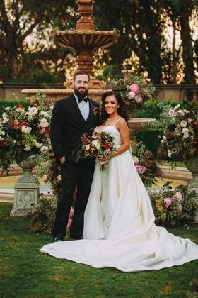 Stephanie Perez and Brandon Hampton at greystone mansion wedding ceremony fountain at altar fall hue