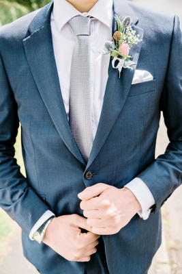 mens blue suit wildflower boutonniere rose greenery blush pink silver tie british english wedding