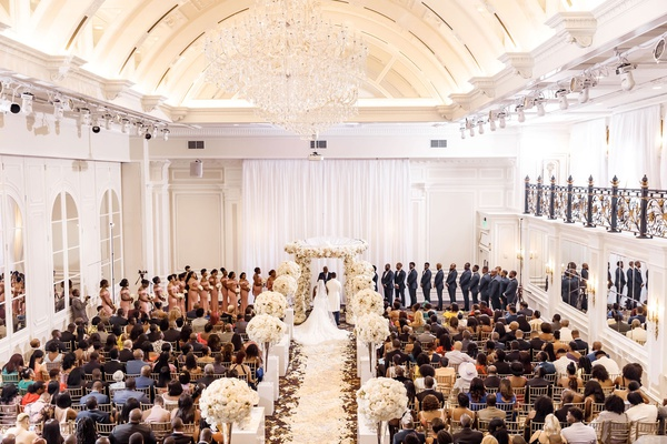 wedding ceremony at the legacy castle white flowers rose petal aisle large guest list
