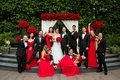 bride in liancarlo, bridesmaids in strapless red dresses, groom in armani, groomsmen in tuxedos