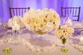 floating candles, bowl of ivory garden roses, trail of flower petals