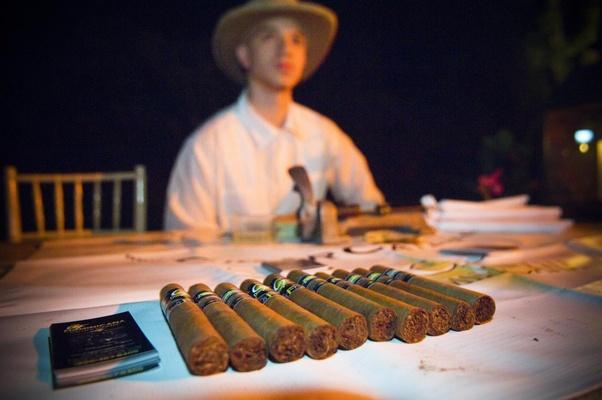 Cigar roller at cigar rolling station wedding reception
