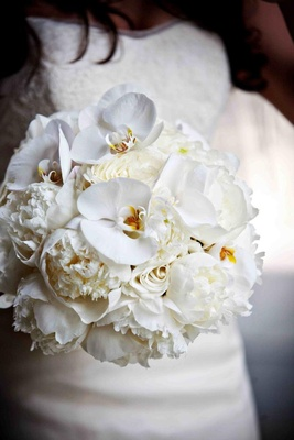 White rose, orchid, and peony wedding bouquet