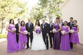 Couple with bridesmaids and groomsmen outside