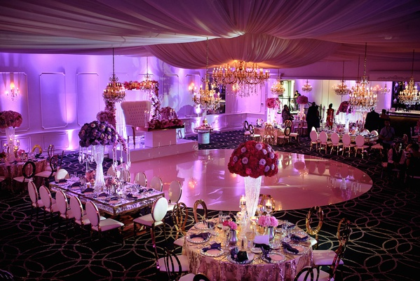 wedding reception glam sweetheart table on stage circle dance floor gold chairs purple lighting pink