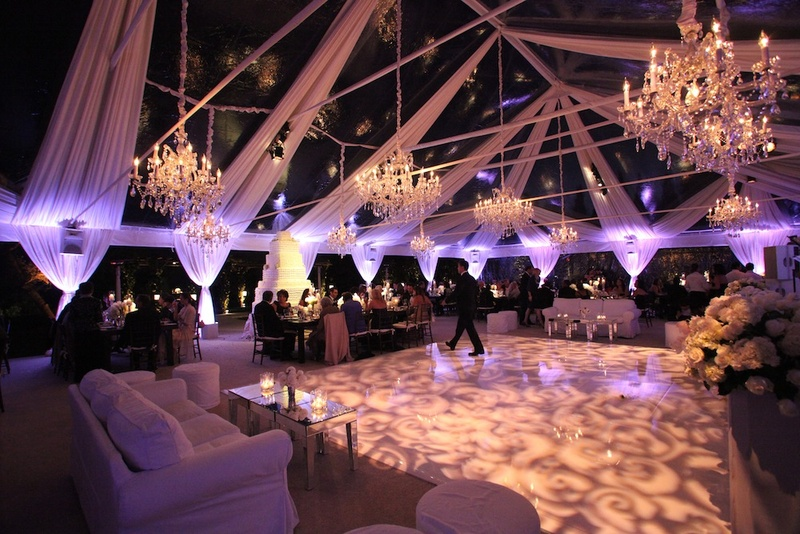 Patterned dance floor with white drapery and chandeliers & Reception Décor Photos - Elegant Tent Wedding - Inside Weddings
