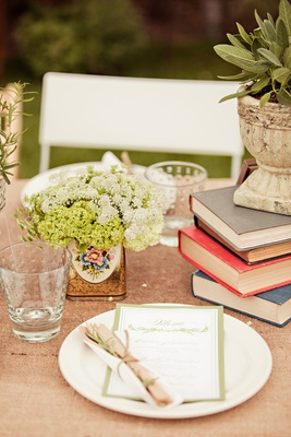 Tablescape with stack of books and flowers