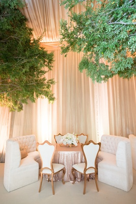 White tufted settee banquette and chairs at wedding