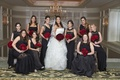 bride in vera wang wedding dress, red rose bouquets, bridesmaids in mismatched black dresses