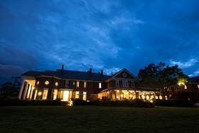 Farmington Country Club at dusk with lights on