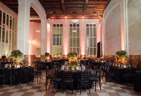 Wedding reception high ceilings black linens round and rectangular tables high medium low flowers