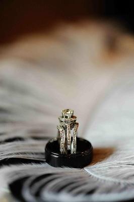 Ebony wedding band and three-band engagement ring
