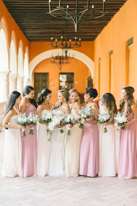 bride in strapless wedding dress bridesmaids in white pink dresses bouquets colombia wedding