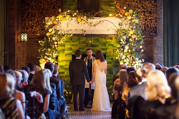 Wedding ceremony Jewish wedding New York green backdrop with white chuppah ceiling and yellow flower