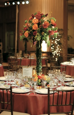 Tall centerpiece with red and orange roses