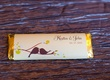 Chocolate bar in gold foil wrapper with custom label