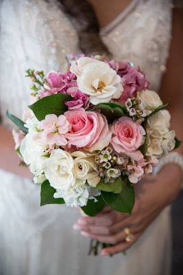 Bride Holding Wedding Bouquet With Pink Rose White Hydrangea And Leaves