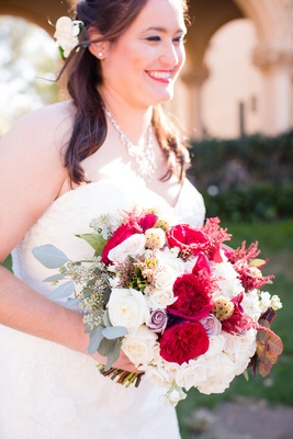 bridal bouquet with white and lavender roses, red garden roses, eucalyptus