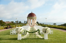 White chairs along petal aisle and rotunda
