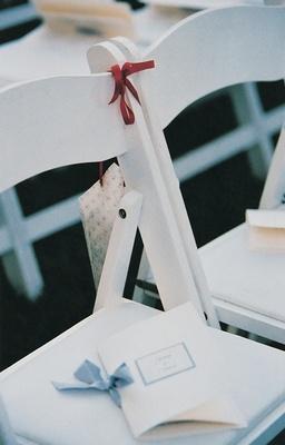 White wedding program on ceremony chair