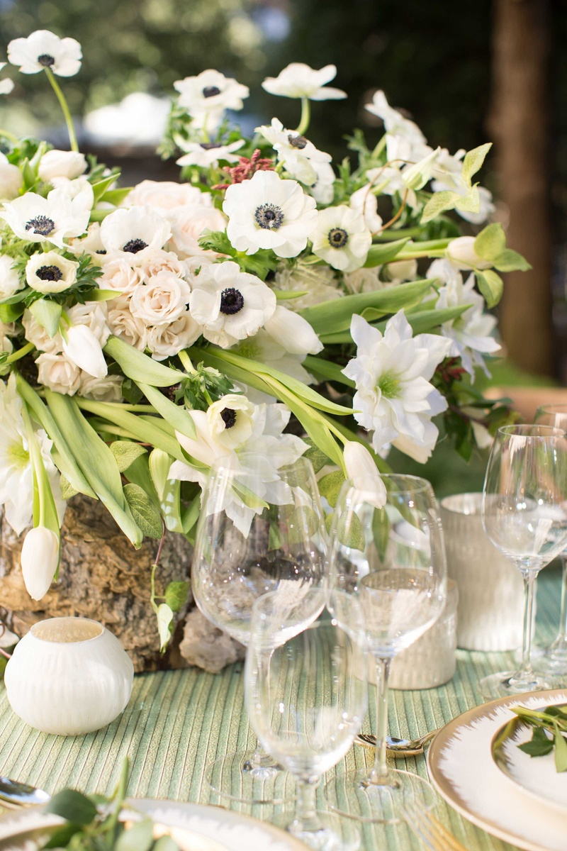 Reception dcor photos full floral arrangement in tree stump green and white floral centerpiece arrangement in tree stump vase green linens white candles reviewsmspy