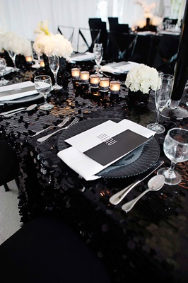 Black and white geometric wedding menu at table